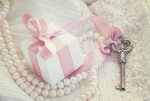 gift box and key with pearl jewellery and white lace, retro toned